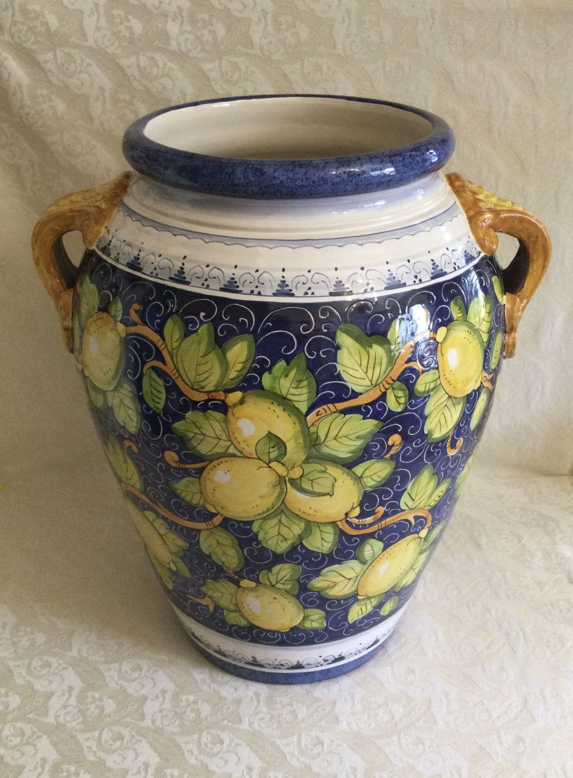Jar h50 with lemons blue background