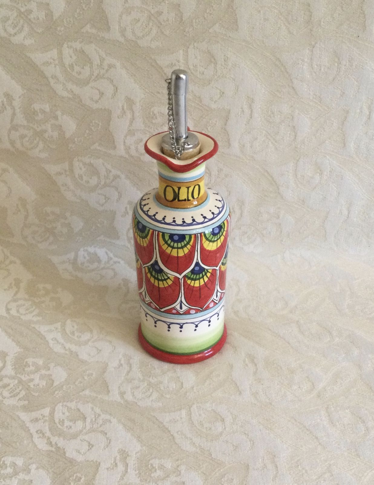 Oil cruet h16 with red peacock feather handle