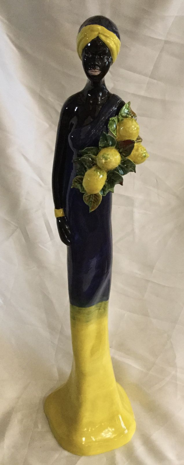 Statua donna africana con limoni  h65 base cm 15